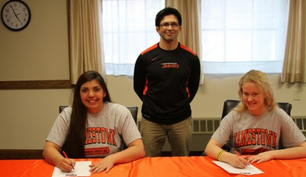 Head Coach Tony DeAnda is shown with Brenna Ramirez (left) and Austin Wortman (right).