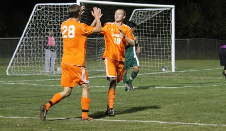 The Jimmies' George Gauld (19) is congratulated by Jade Johnson after his 1st half goal