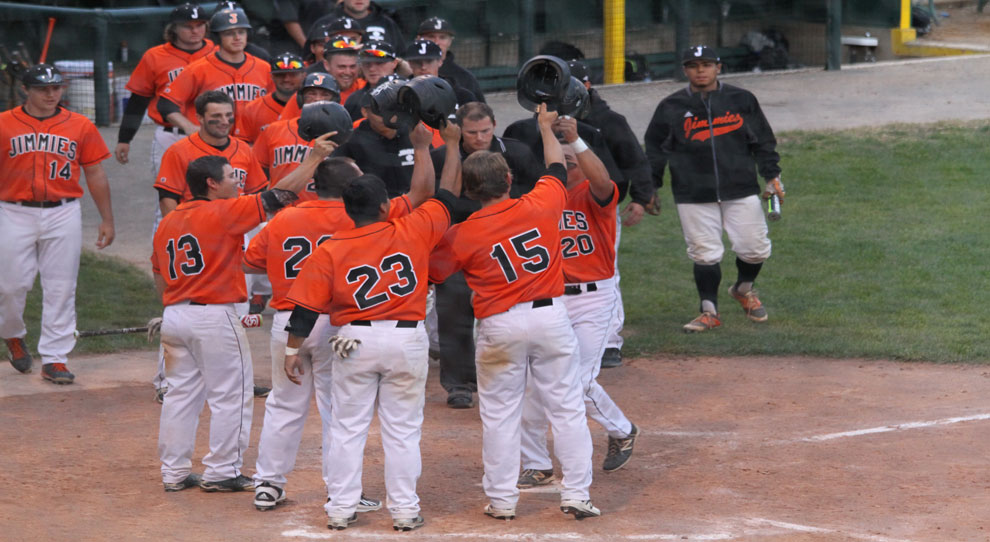 Quinn Irey (20) is mobbed by teammates after his grand slam Wednesday