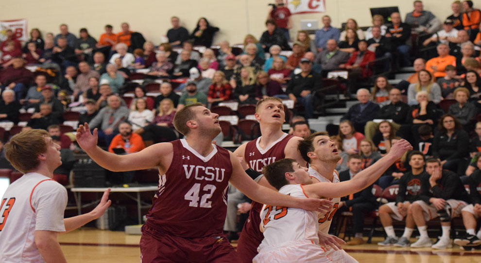 Players vie for position on a rebound in Saturday's game (photo courtesy of VCSU sports information)
