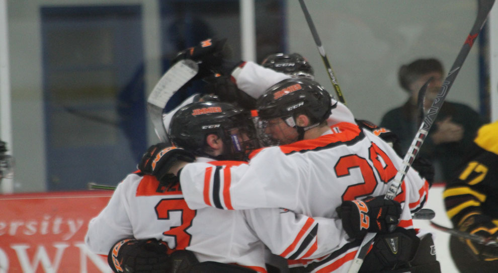 Cole McKechney (left) is congratulated after his second goal of the game put UJ ahead 3-2