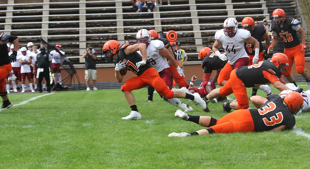 The Jimmies' Allen Jevning runs for a gain in Saturday's game